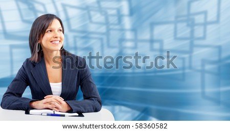 Smiling business woman. Over blue abstract background - stock photo
