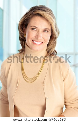Smiling business woman. Over blue background