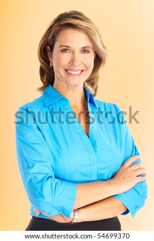 Smiling business woman. Over brown background - stock photo