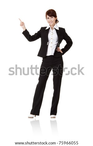 Smiling business woman pointing and presenting, full length portrait isolated on white background. - stock photo