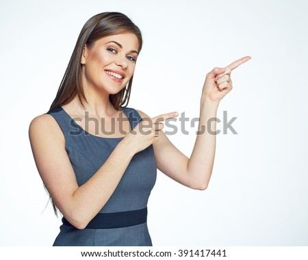 Smiling business woman pointing finger on copy space. isolated portrait. - stock photo