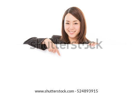 Smiling business woman pointing on billboard over white background