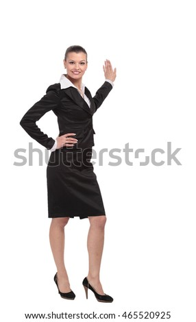 Smiling business  woman points to advertise on the wall