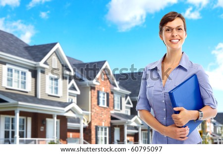 Smiling business woman. Real estate agent - stock photo
