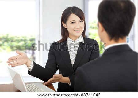 smiling Business woman showing at laptop and explaining a plan of work to client - stock photo