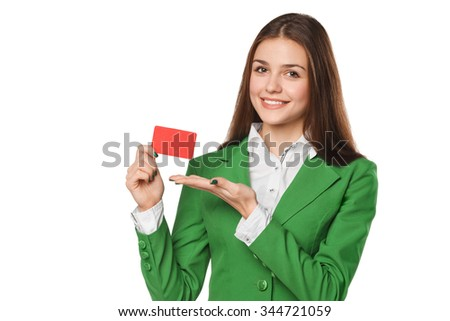 Smiling business woman showing blank credit card in green suit, isolated over white background - stock photo