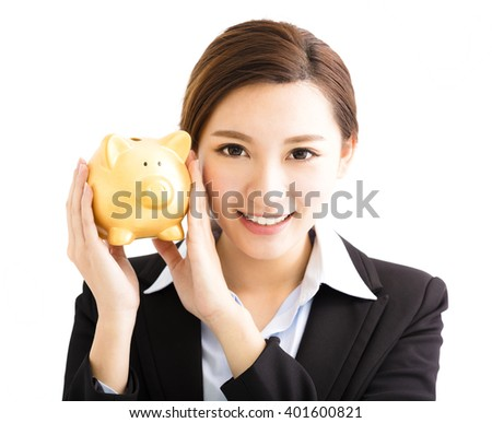 smiling business Woman showing the  piggy bank - stock photo