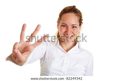 Smiling business woman showing three fingers of one hand - stock photo