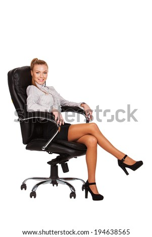Smiling business woman sitting in chair. - stock photo