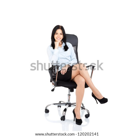 Smiling business woman sitting in chair. young businesswoman smile isolated over white background - stock photo