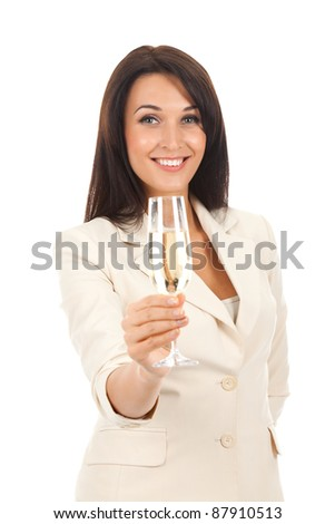 Smiling business woman standing holding a glass of champagne. Isolated over white background