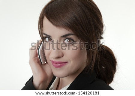 Smiling business woman talking on mobile phone - stock photo