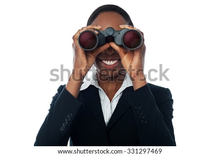Smiling business woman using binocular