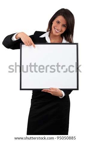 Smiling business woman with a blank board ready for text or image - stock photo