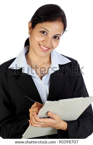 Smiling business woman with clipboard - stock photo