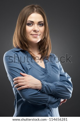 Smiling business woman with folded hands against gray background. - stock photo