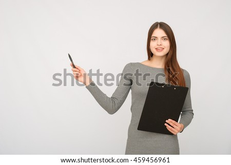 Smiling business woman with folded hands against . Toothy smile, crossed arms.