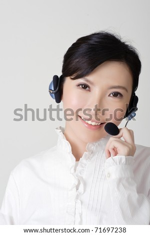 Smiling business woman with headphone, closeup portrait. - stock photo