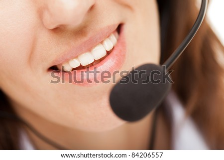 Smiling business woman with headphones or headset - stock photo