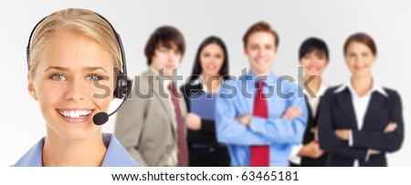 Smiling  business woman with headset and business people - stock photo