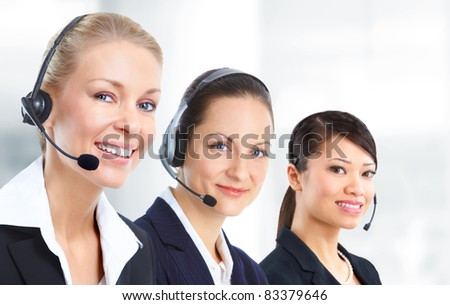 Smiling business woman with headsets. In the office. - stock photo