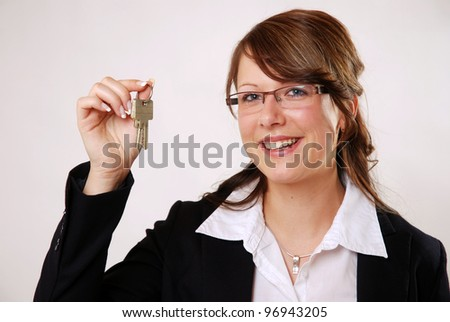 smiling business woman with house keys - stock photo