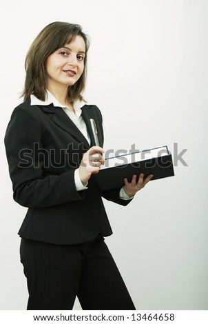Smiling business woman with notepad and pen