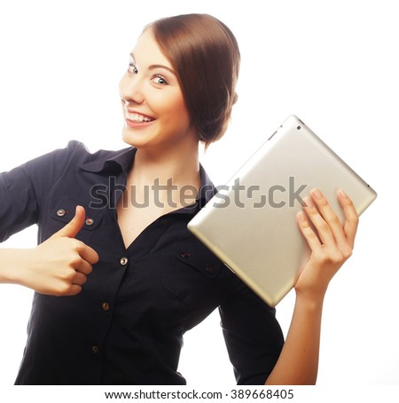 Smiling business woman with tablet thumb up show. - stock photo