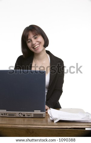 Smiling business woman working at her computer