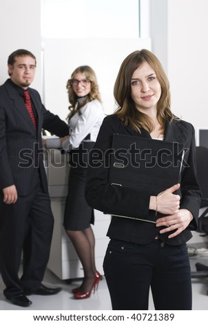 Smiling business woman working in office