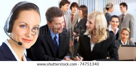 Smiling business woman working in the office - stock photo