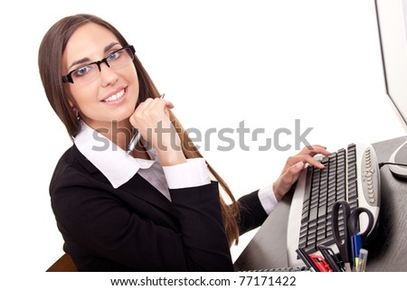 smiling business woman working on computer in office - stock photo