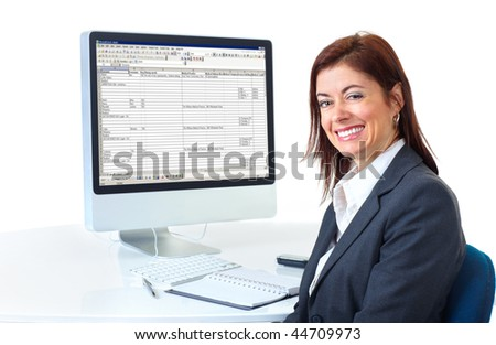 Smiling business woman working with computer. Isolated over white background - stock photo