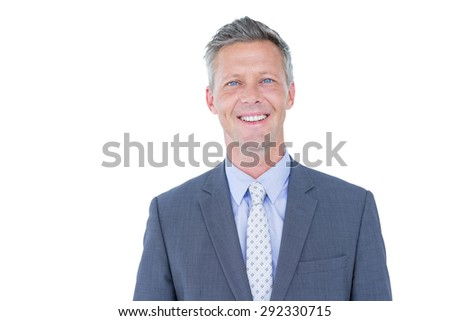 Smiling businessman against a white background looking at the camera
