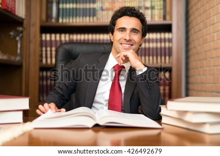 Smiling businessman at work in his office - stock photo