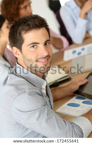 Smiling businessman attending business meeting - stock photo