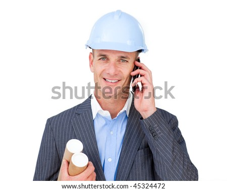 Smiling businessman calling by phone at the office