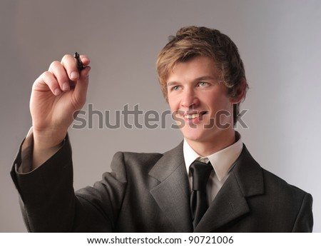 Smiling businessman drawing - stock photo