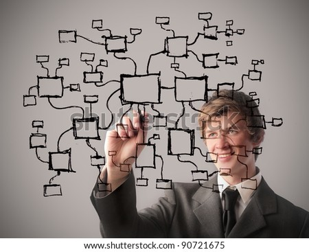 Smiling businessman drawing a flow diagram - stock photo