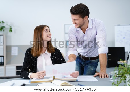smiling businessman explaining something to his colleague - stock photo