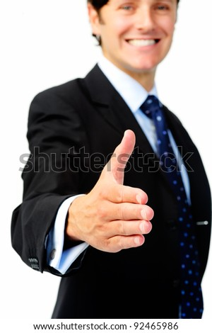 Smiling businessman extends his arm for a congratulatory handshake - stock photo