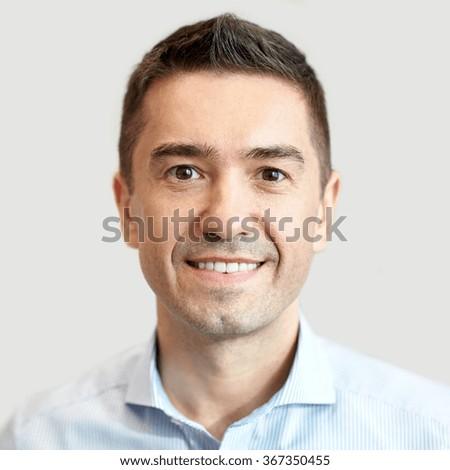smiling businessman face or portrait - stock photo