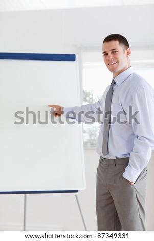 Smiling businessman giving a presentation - stock photo