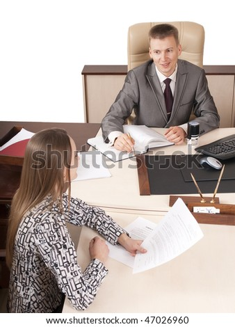 smiling businessman going through some files with a colleague or client