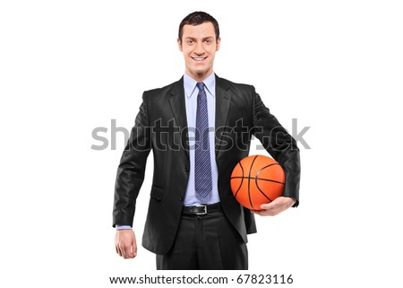 Smiling businessman holding a basketball isolated against white background - stock photo
