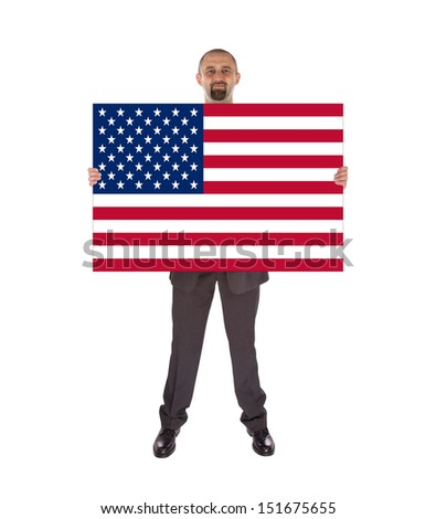 Smiling businessman holding a big card, flag of the United States, isolated on white