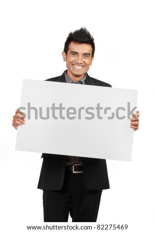 smiling Businessman holding a blank card isolated on white background - stock photo