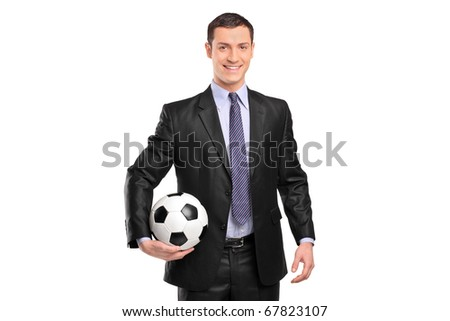 Smiling businessman holding a football isolated on white background - stock photo