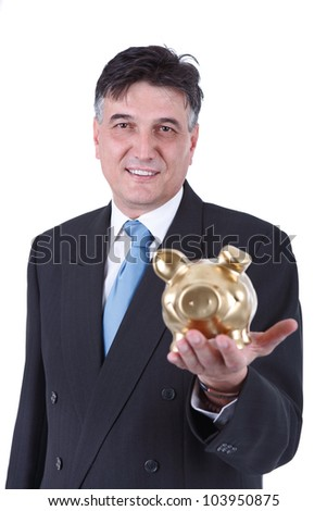 Smiling businessman holding a piggy bank, he is looking at the camera - stock photo