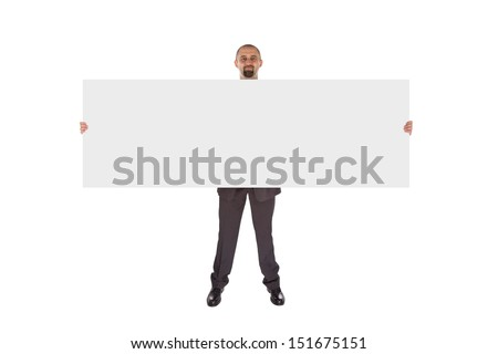 Smiling businessman holding a really big blank card, isolated on white
